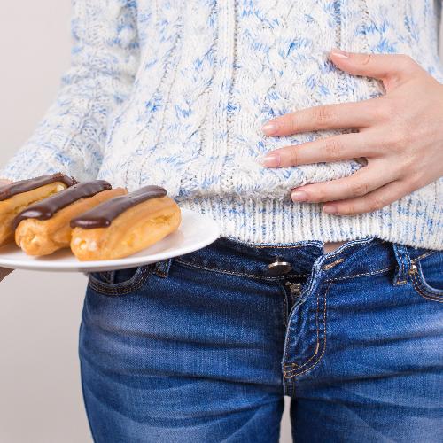 Misselijkheid door overmatig eten.